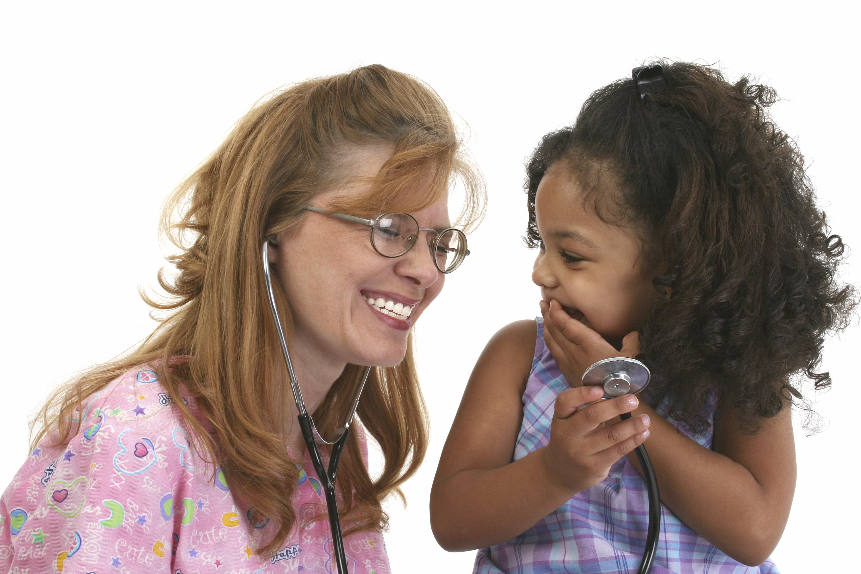 Little girl and smiling friendly nurse with stethoscope. Shot with a Cannon 20D.